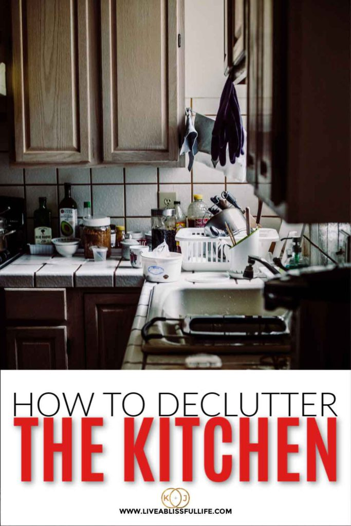 text: how to declutter the kitchen img: very cluttered kitchen counter