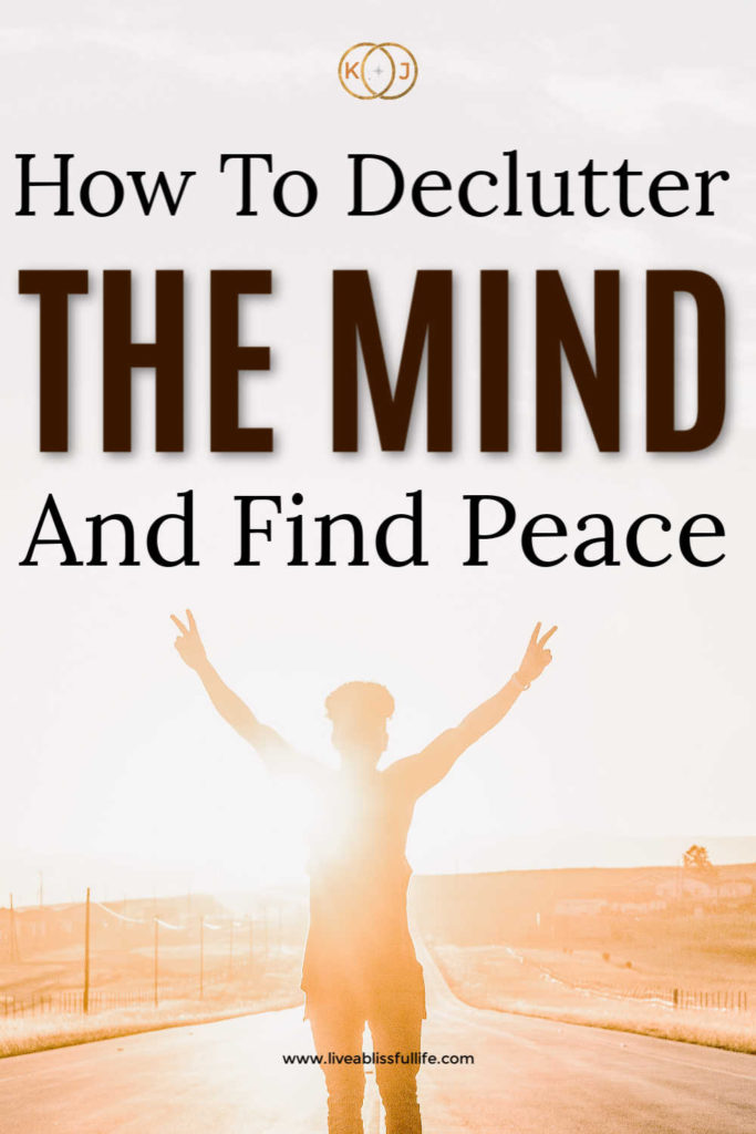 text: how to declutter the mind and find peace image: person holding both hands up in a peace sign