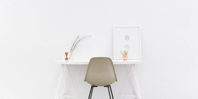 white desk with beige bucket chair