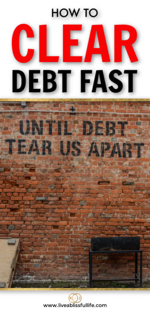 text: how to clear debt fast image: brick wall with the words until debt tear us apart