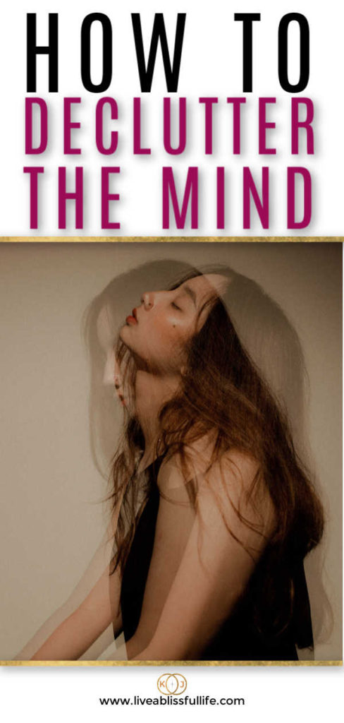 text: how to declutter the mind image: woman in black shirt looking exhausted
