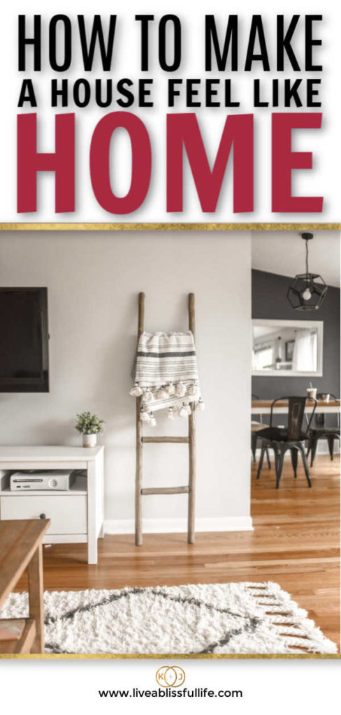 text: how to make a house feel like home image: clean living room with a view towards the kitchen