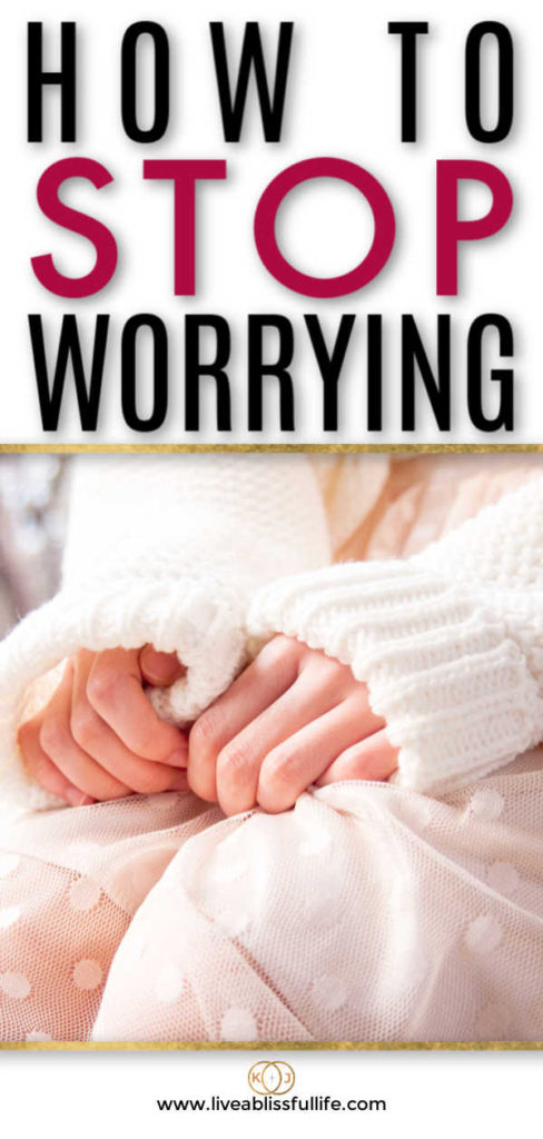 text: how to stop worrying image: two hands clutching a white dress
