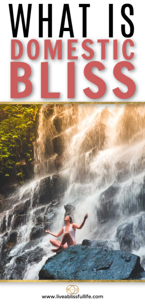 text: what is domestic bliss image: woman relaxing on a rock in front of a waterfall