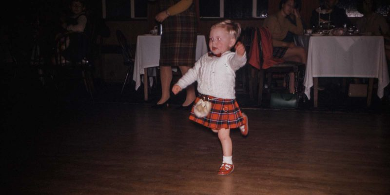 a young boy in a kilt