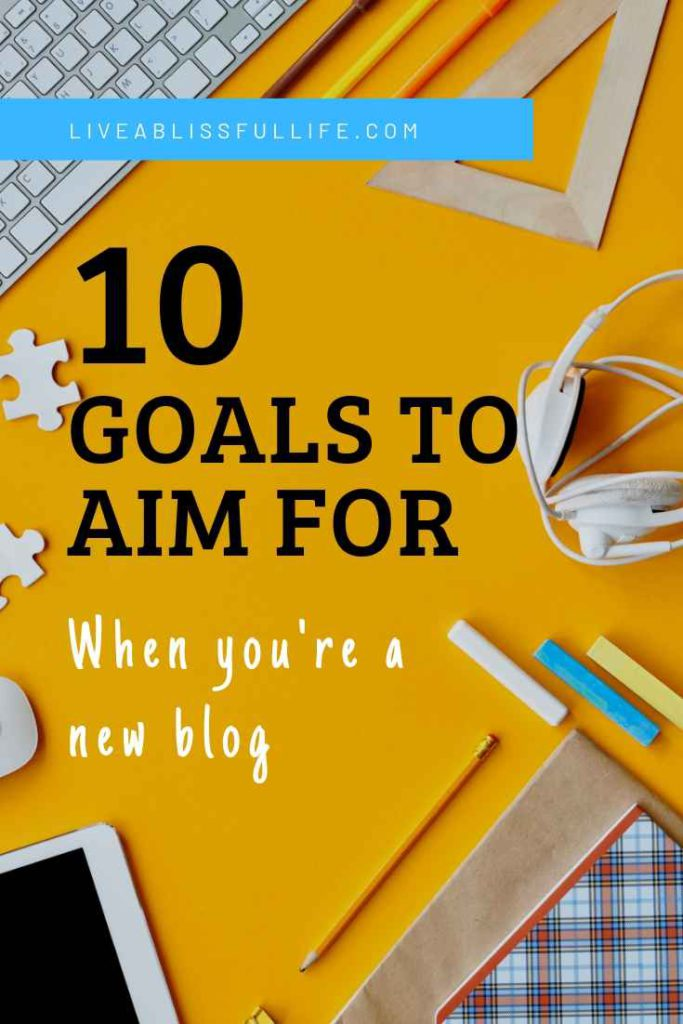 image: yellow table with keyboard and other office supplies text: 10 goals to aim for when you're a new blog