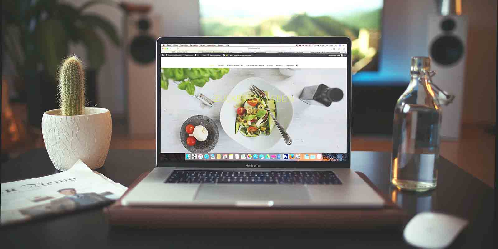 how-to-launch-a-website-for-free-laptop-opened-to-a-food-blog