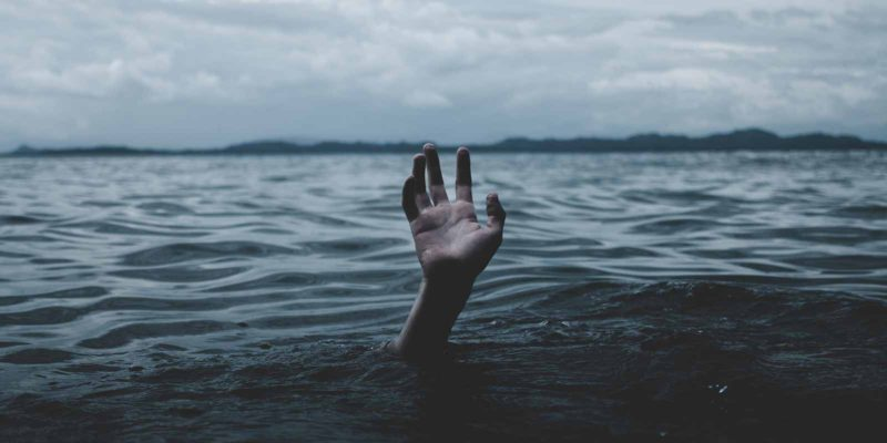 self-help-strategies-for-depression-hand-reaching-up-from-water