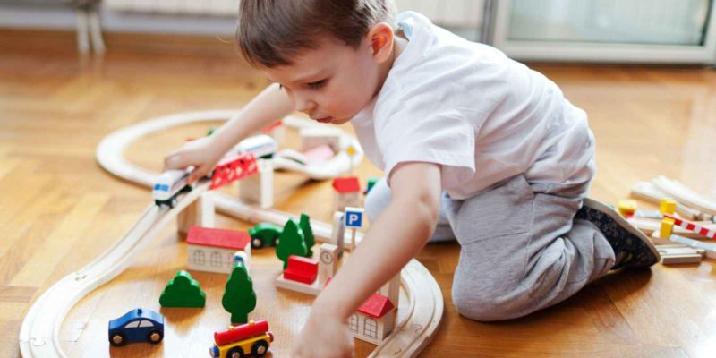 toddler playing with train set - The Top Christmas Gifts For Train Loving Toddlers