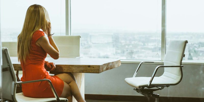 a womans guide to buying a business businesswoman in red while on the phone
