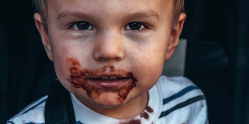 my toddler has become a picky eater - boy with chocolate smear around his mouth