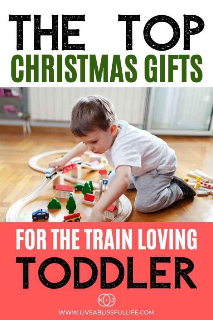 Image: Toddler playing with a train set Text: The Top Christmas Gifts For The Train Loving Toddler
