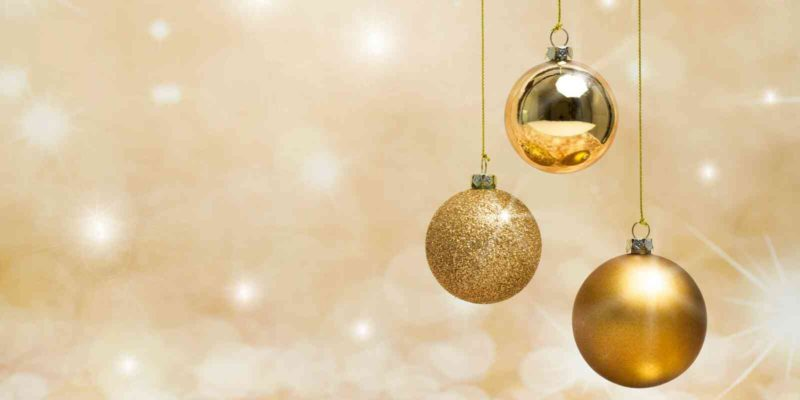 what to do when you re home alone on Christmas - Gold Christmas Balls Against Gold Background