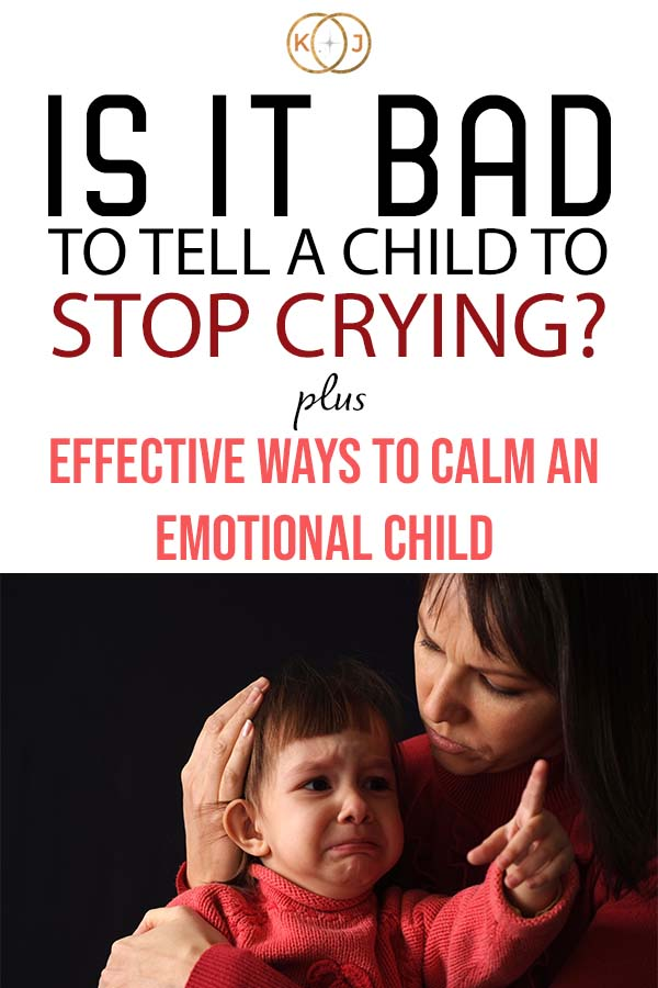 Image: Mom holding a crying child Text: Is it bad to tell a child to stop crying? Plus Effective Ways To Calm An Emotional Child