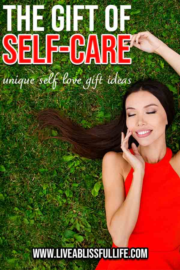 Image: Asian woman in red dress lying on green grass Text: The Gift Of Self-Care: Unique Self-Love Gift Ideas