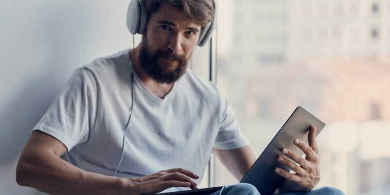 handsome man with headphones using a laptop